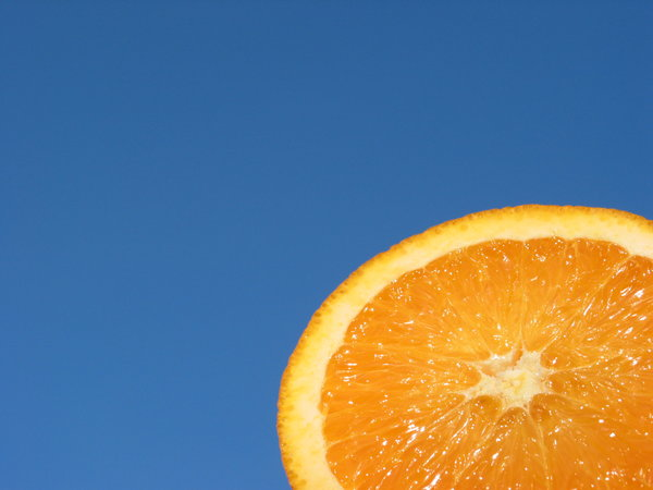 Orange and Blue 1: Natural high contrast - crisp and fresh orange with blue sky background. Put the orange on a metal stick and held it up against the evening sky slightly tilted towards the sunlight.