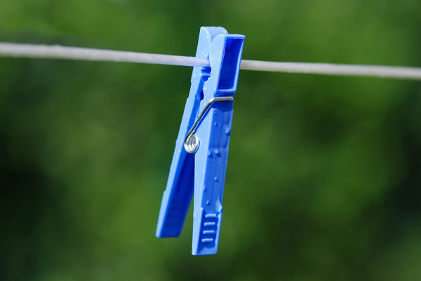 Clothes Peg 2: Just a stock photo. Wet clothes peg on wire.
