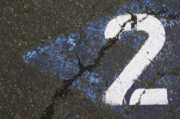 Two: The number two painted on asphalt.
