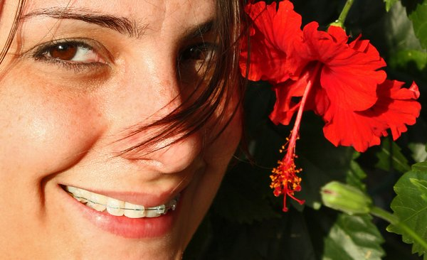 Braces & Flower: My wife Linda Pulgar shows off her braces with a nice cayenne flower