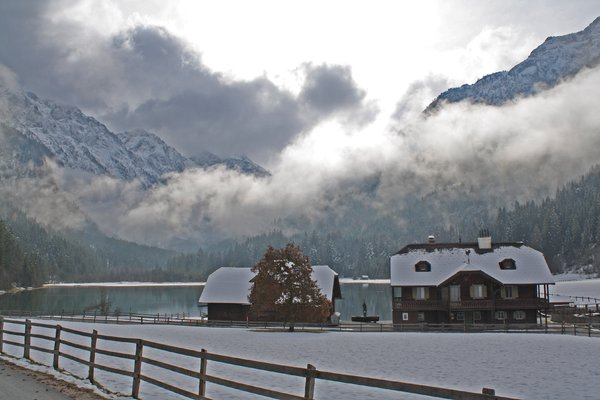 "winter is coming at the lake: late autumn in wagrain/kleinarl at the ""jägersee"" = hunters lake - austria"
