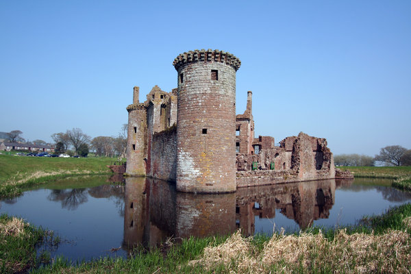 Caerlaverock Castle  3: Surrounded by a double moat and hundreds of acres of flat marshy willow woods , Caerlaverock was built to control the South-West entrance to Scotland which in early times was the waterway across the Solway Firth. Building began in about 1277, and by 1300