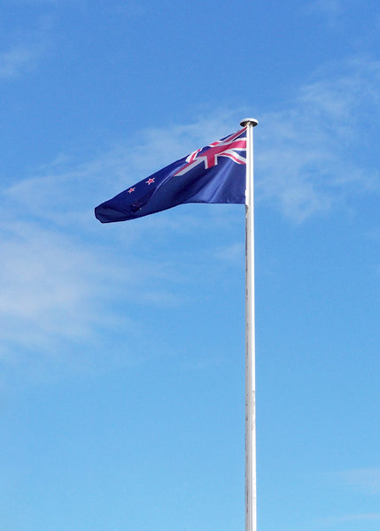 New Zealand flag: Flag of the Pacific nation of New Zealand.The Union Jack in the corner and four red stars for the Southern cross, framed in white