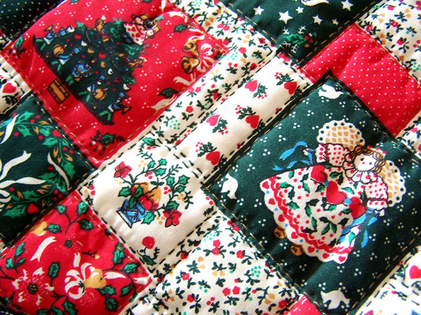 My Xmas stocking: the fabric of my quilted Xmas stocking.  I made one for each one in the family years ago. It's cheat quilting, because there is no actual piecing together.