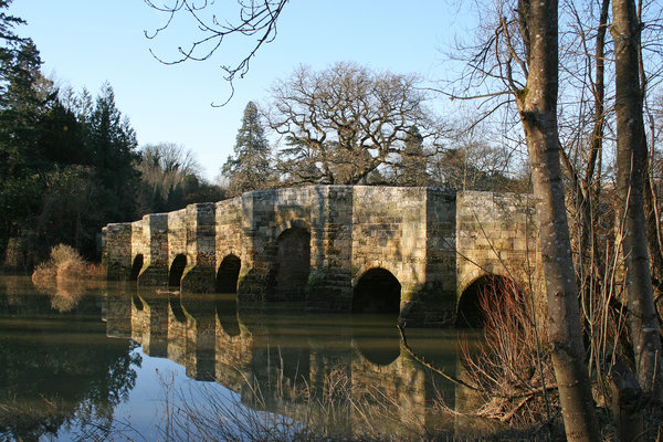 Old stone bridge: An old stone bridge in West Sussex, England, in early spring.