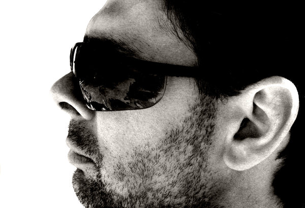 Male Profile: Simple profile showing some stuble and bulbous sunglasses.