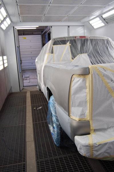 Time to paint!: A truck ready to be painted in a professional paint booth.
