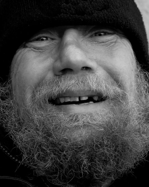 Smiling Homeless: Randy, A familiar figure on the streets of downtown Milwaukee, muggs my camera