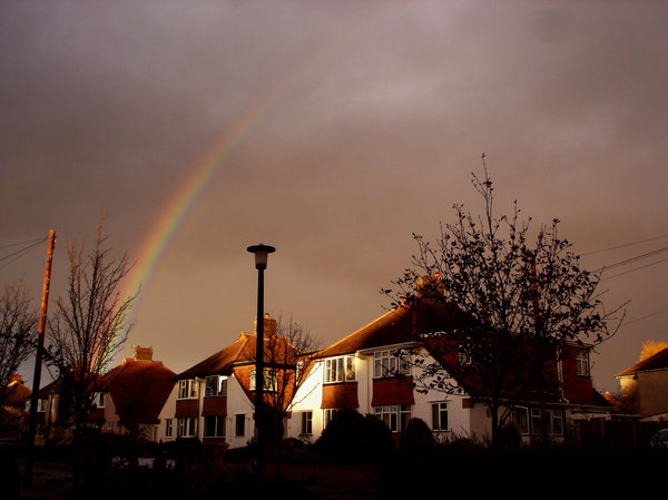 Autumn Scene: Early afternoon in November. No rain, just a great scene of a sunlight on the houses and a rainbow.