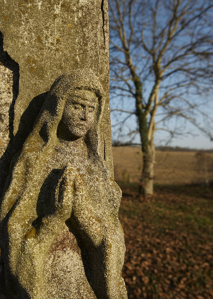 Maria's prayer: statue of Maria by the street in countryside of Hungary