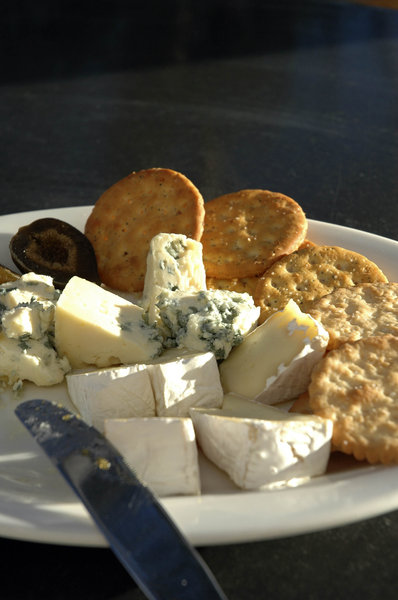 Cheese plate: Cheese plate with blue, brie and crackers.NB: Credit to read