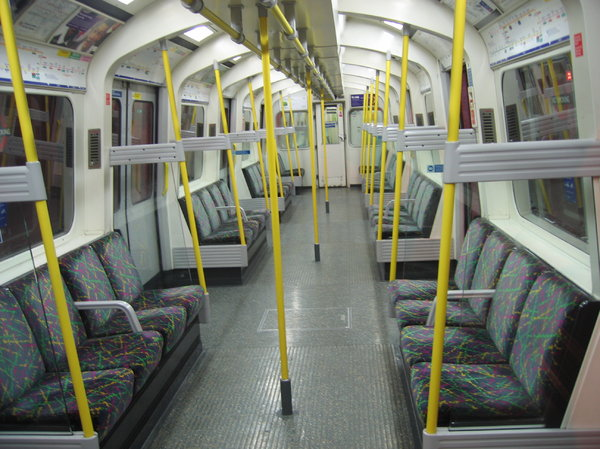 tube train interior: you have to get up rather early to see a london tube train this empty. It's not quite rush hour ;-)
