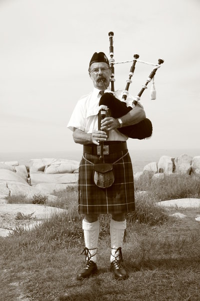 Bag Piper: Bag Piper at Peggy's Cove, Nova Scotia, Canada.  Taken with