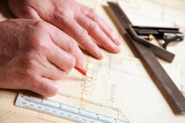 Plan Drawer: Hands and a drawing board