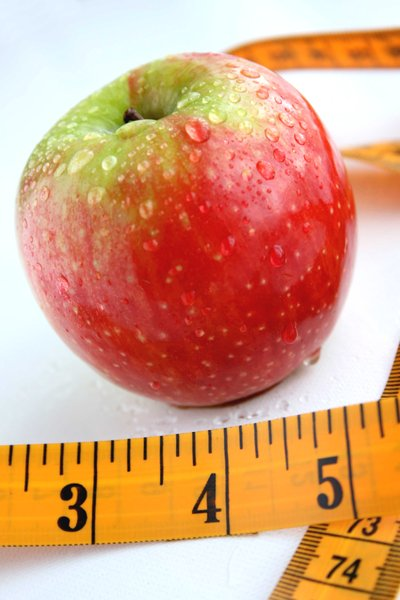 Apple & Tape Measure: Apple and tape measure healthy diet concept