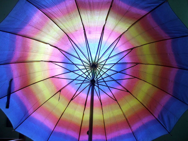 rainbow brolly: rainbow coloured umbrella