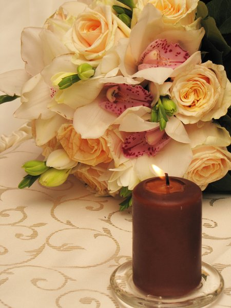 candle: candle and flowers at a wedding