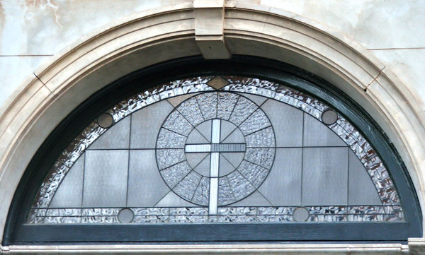 arched window and cross