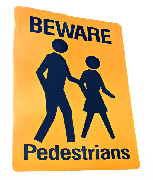 dangerous pedestrians: black on yellow street sign warning of pedestrians crossing road