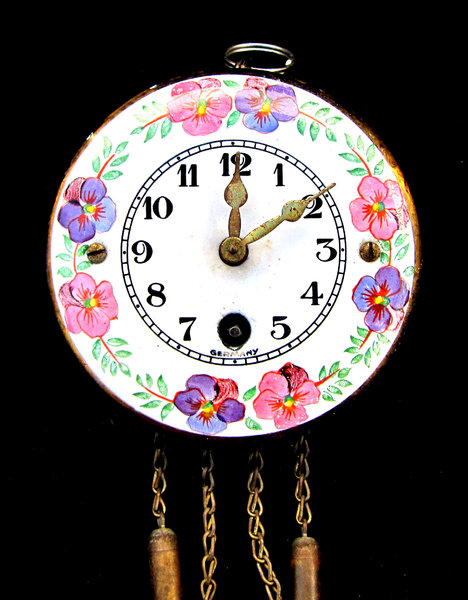 just in time: small floral ceramic pendulum clock