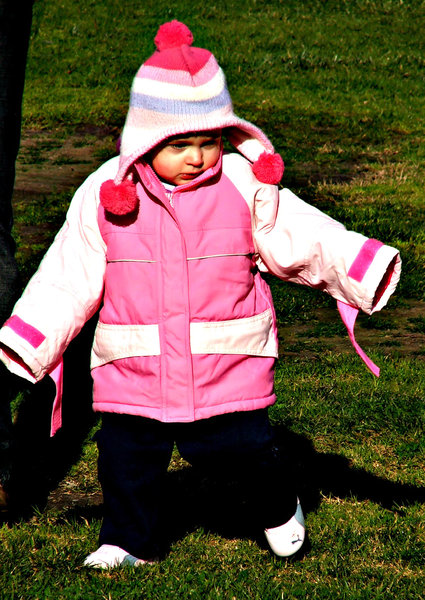 look - no hands!: toddler dressed up for winter weather with hands inside sleeves