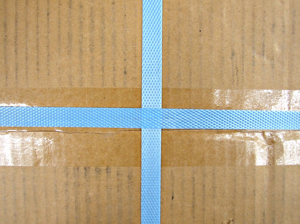 wrapped, sealed and bound: brown cardboard box taped and securely bound with blue nylon binding tape