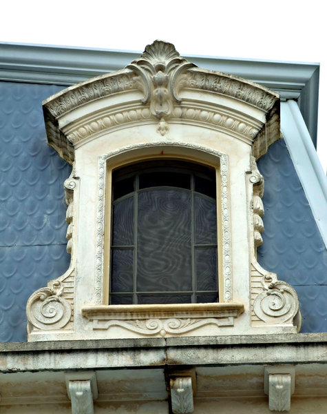 framed: ornamental Victorian stone-work dormer style window frame