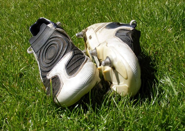 football boots: Pair of football boots left a side of pitch