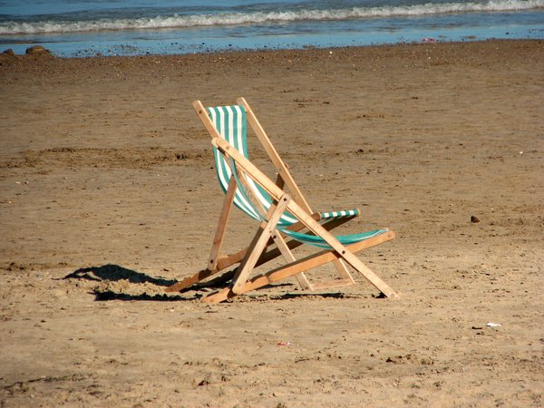 Lonely Beach: a couple of deck chairs left on  the beach