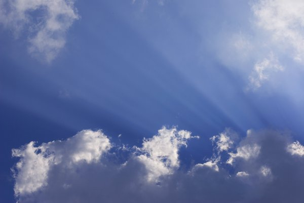 rays: puffy white clouds with rays