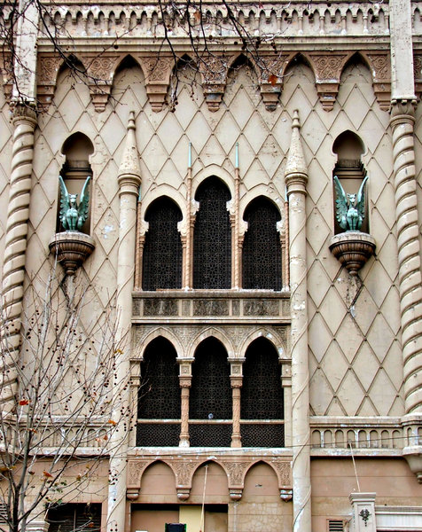 Moorish style gargoyles: gargoyles, grotesques and dragons on old city building in arabesque/Moorish architectural style