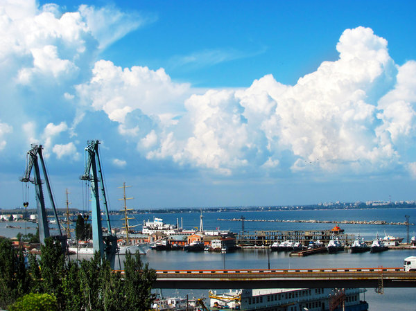 Odessa sky 2: bright blue sky and clouds over Odessa port with cranes