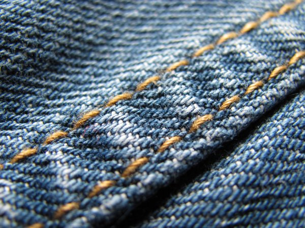 Jeans texture: close-up of a jeans seam