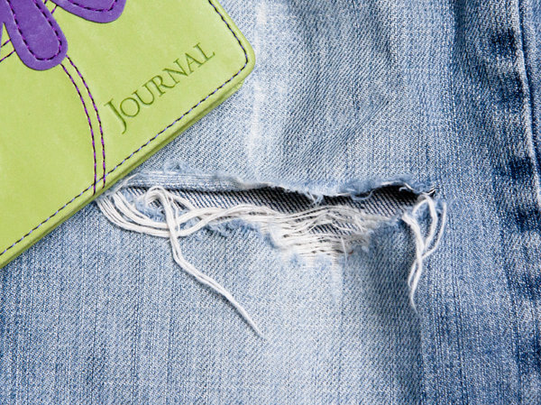 Denim Days: a journal sitting on torn jeans