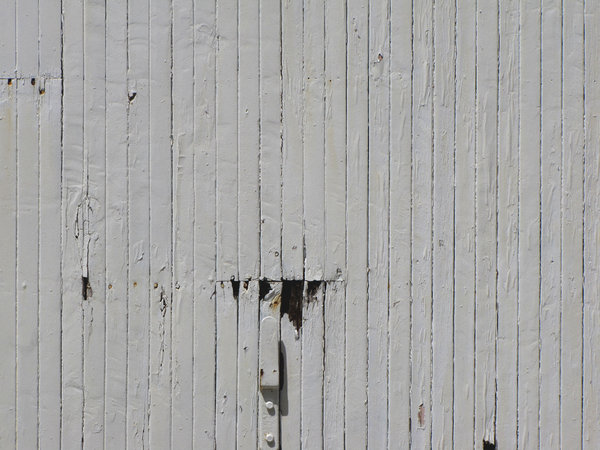 lines of grey: wall of old wooden railway carriage
