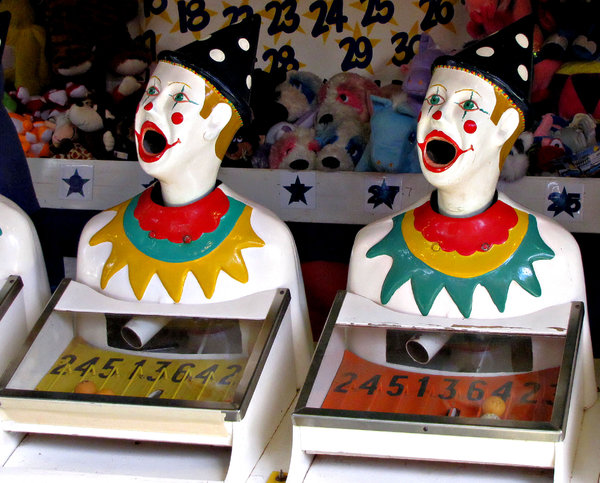 clowning around1: carnival clown heads at games booth