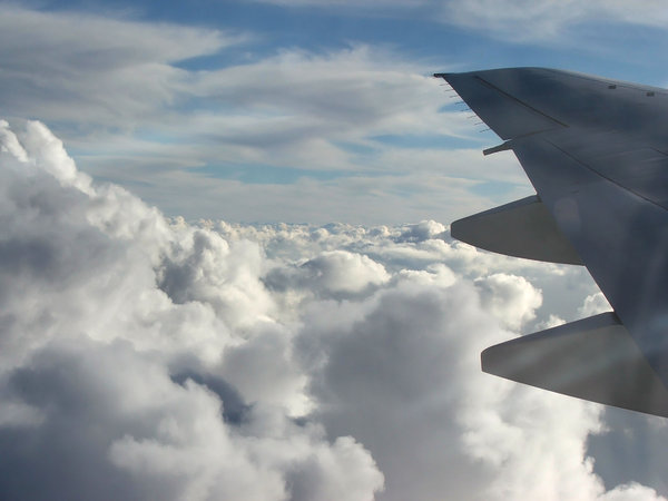 above the clouds: clouds seen through plane window during flight