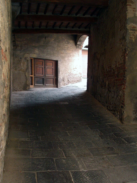 Dark pathway: an old stony-tunnel in montepulciano, italy