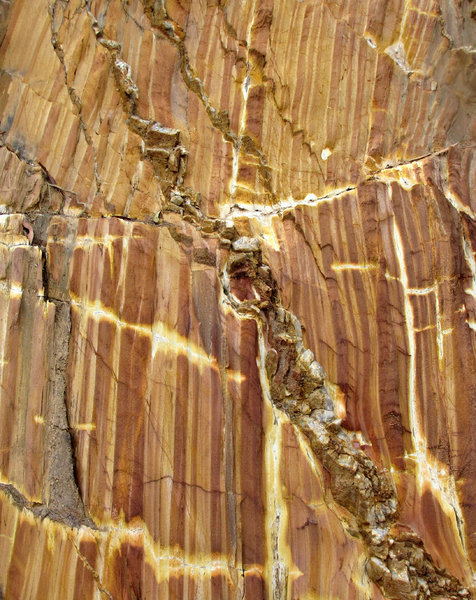 cracked up: cracks, fissures and colours of hillside rock-face