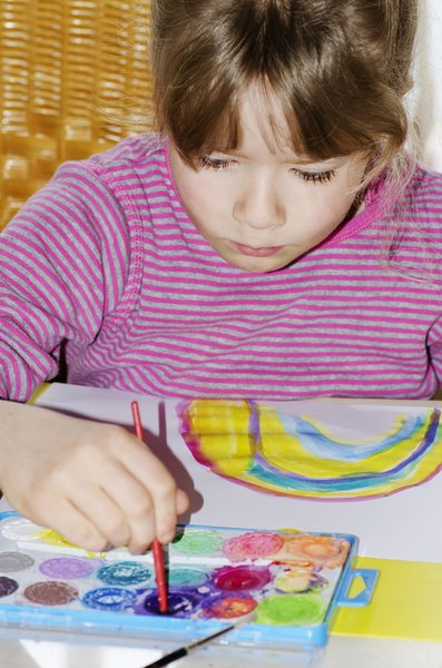 Painter: Child concentrating on her painting
