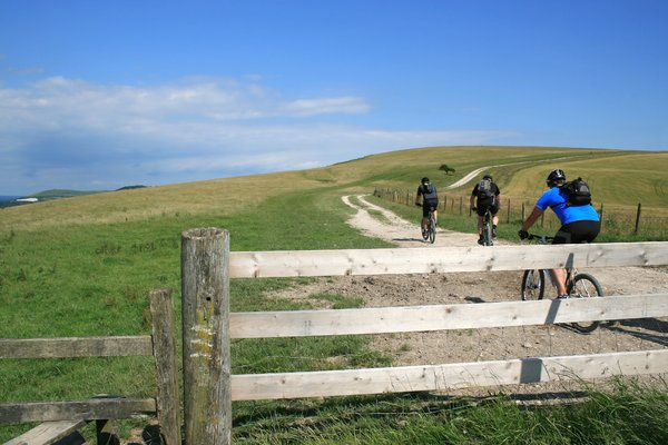 Cycling: Cross-country cyclists on a chalky ridge of the South Downs, West Sussex, England, in early July.