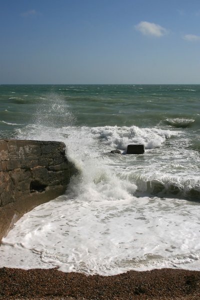 Violent waves: Waves crashing against a groyne on the coast of West Sussex, England.