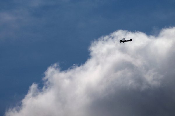 Small airplane: Small propeller airplane alone in the cloudy sky
