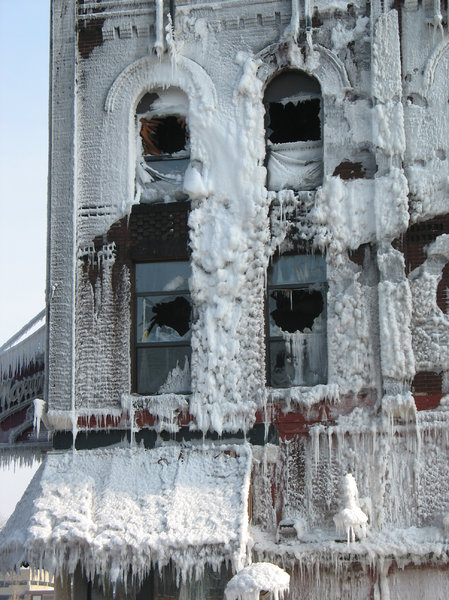 fire and ice: sheets of ice cling to the sides of a burned out building.