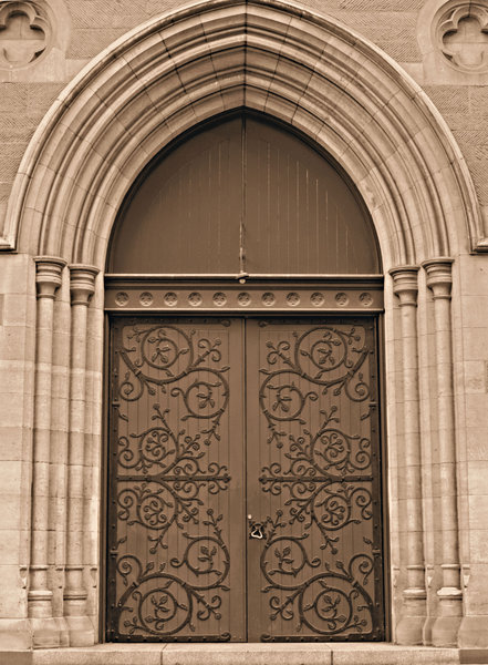closed doors: sepia image of closed doors of a cathedral church