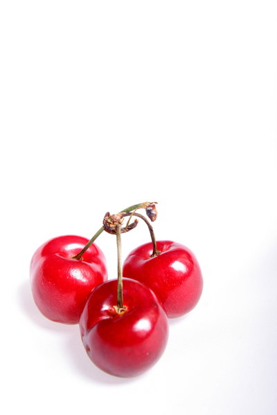 Three Cherries: Three cherries isolated on white