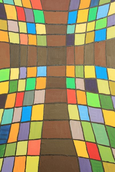 Colourful cross: Shots of a colourful cross painted in coloured squares on canvas