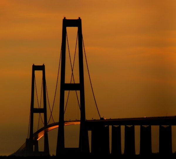 Bridge in evening light: Brigde in the last sunlight of the day. The bridge is Storebaelt in Denmark.