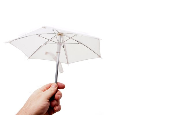 Holding small white umbrella