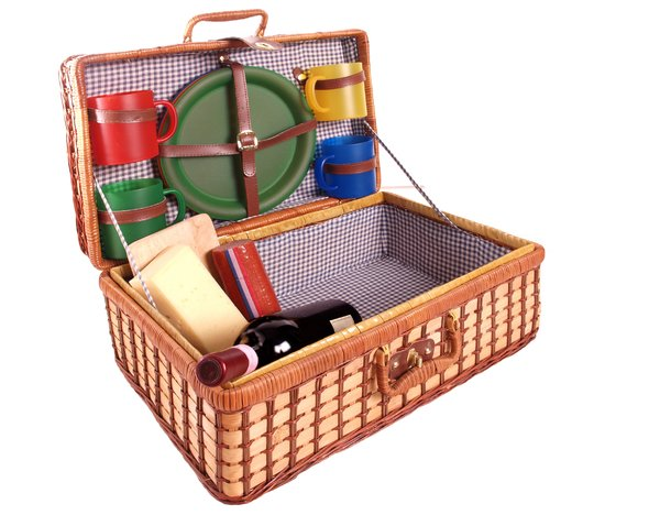 Open picnic basket: Open picnic basket with cups, plates, a bottle of wine, cheese and a sausage. Isolated with white background.